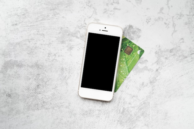 Top view smartphone with credit card