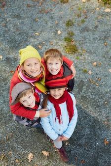 Top view of smiling schoolchildren