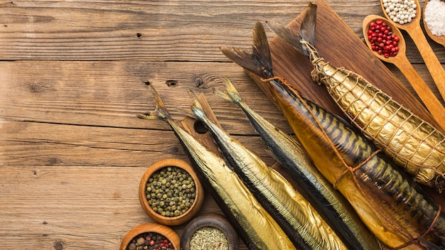 Top view smoked fishes on wooden table