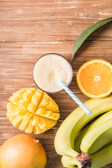 Top view smoothie with bananas and oranges
