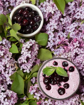 Top view smoothie with cherries and hyacinth