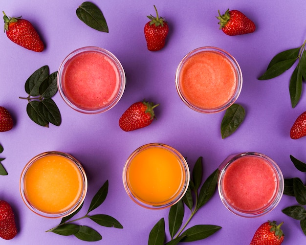 Top view smoothies on purple background