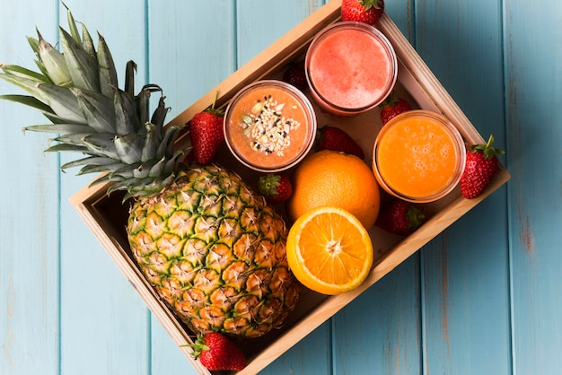 Top view smoothies with pineapple