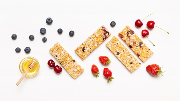 Top view snack bars with fruits