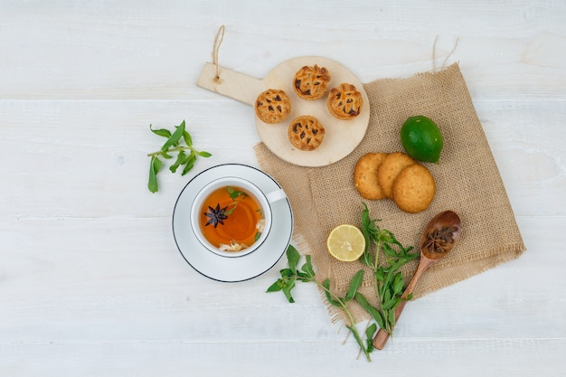 Top view of snacks with herbal tea