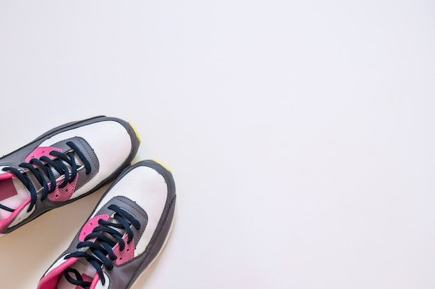 Top view of sneakers on white background. fitness wear and equipment. sport fashion, sport accessories, sport equipment.healthy concept copy space. concept healthy lifestyle, sport and diet. sport equipment.