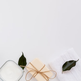 Top view of soap and body butter on plain background
