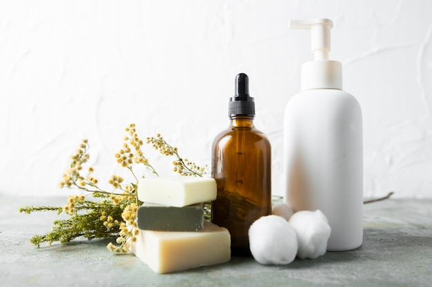 Top view soap and serum on table