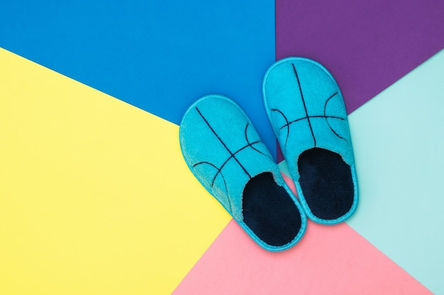 Top view of soft slippers on a colorful surface. comfortable home shoes. flat lay.