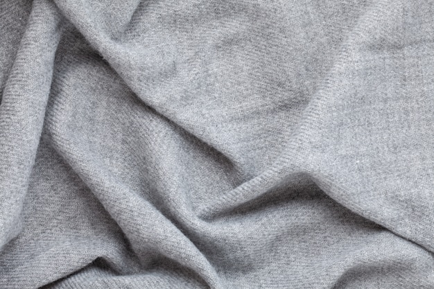 Top view over soft woolen grey textil texture