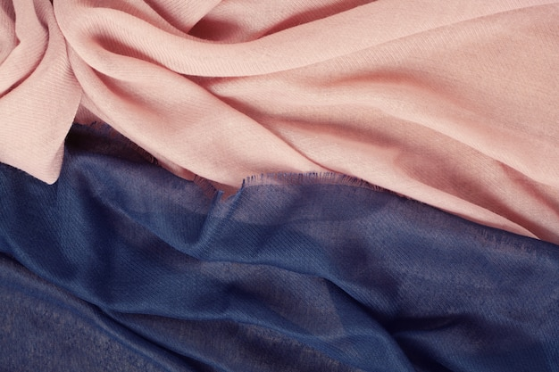 Top view over soft woolen pink and blue textil texture
