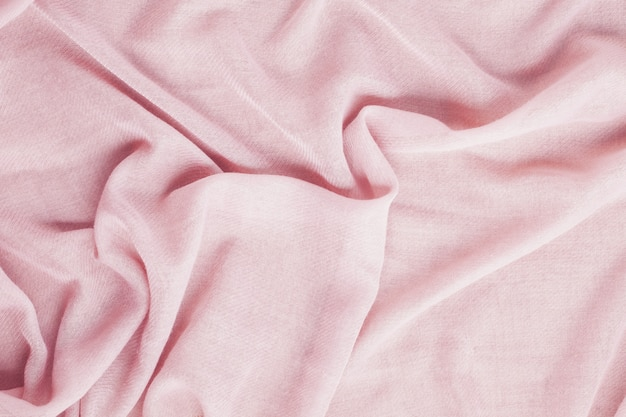 Top view over soft woolen pink textil texture