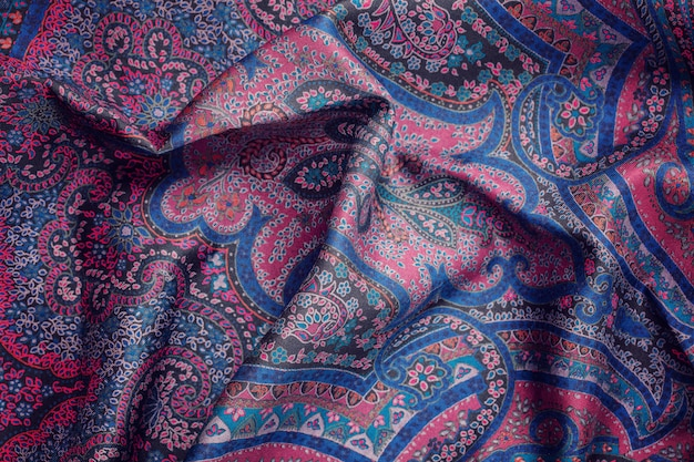 Top view over soft woolen textil texture with ornament
