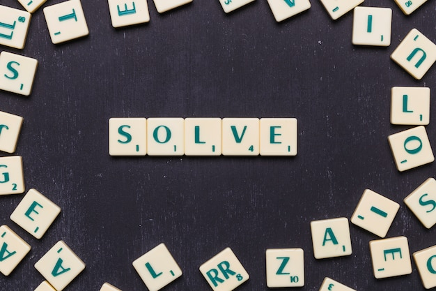 Top view of solve text made from scrabble game letters