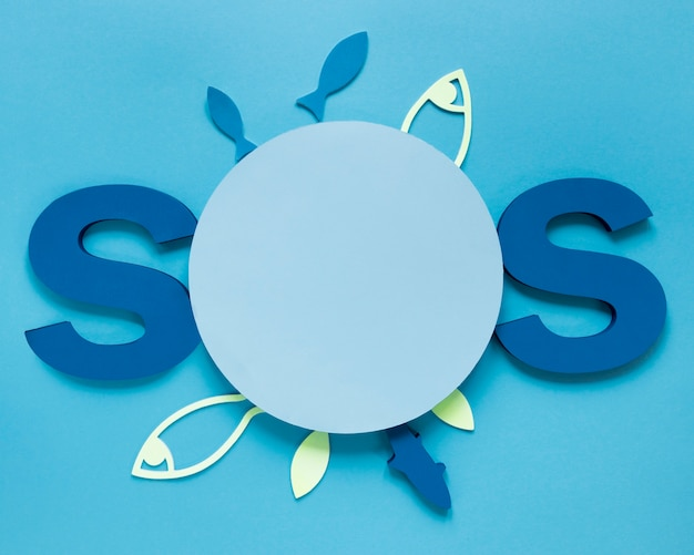 Top view of sos with paper fish