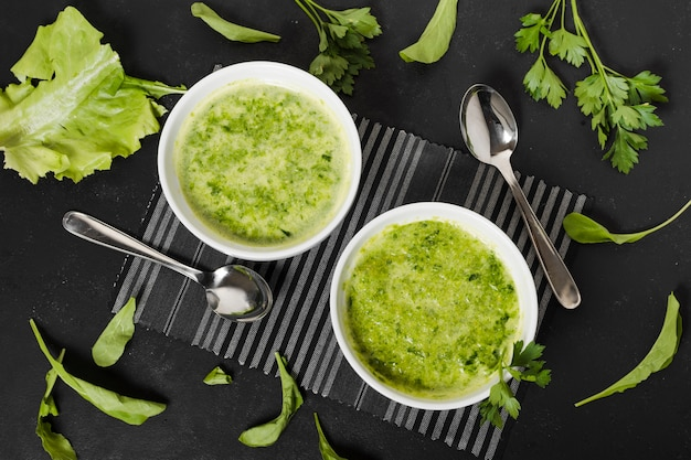 Top view of soup bowls with parsley