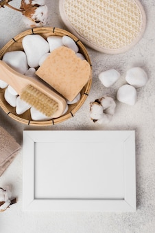 Top view spa accessories with stones and soap