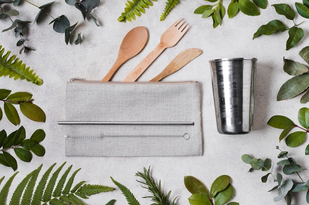 Top view spa and beauty cutlery and leaves