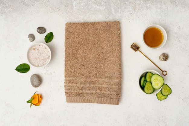 Top view spa concept with towel and honey