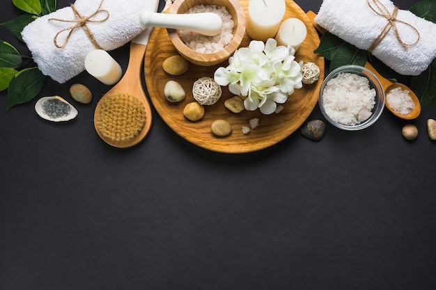 Top view of spa products on black background