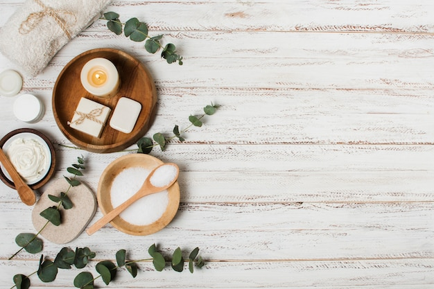 Top view spa products on wooden background