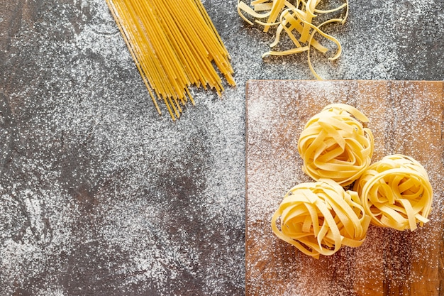 Top view of spaghetti on plain background