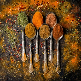 Top view spice with pepper and cinnamon and turmeric in spoon