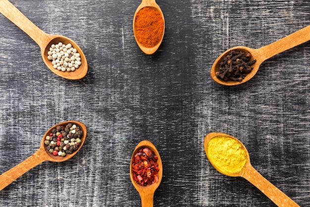 Top view spices powder on spoons