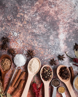 Top view spices on rusty background