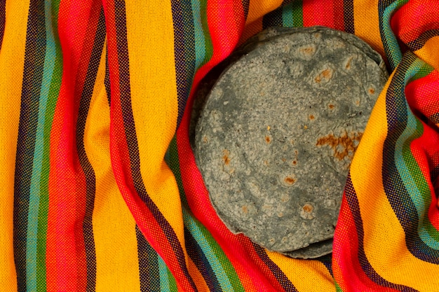 Top view spinach tortilla on fabric
