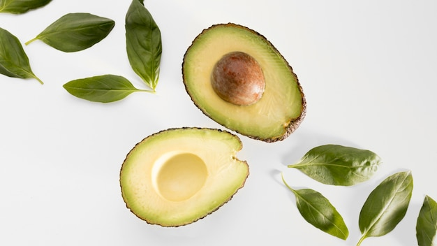 Top view of spinach with avocado