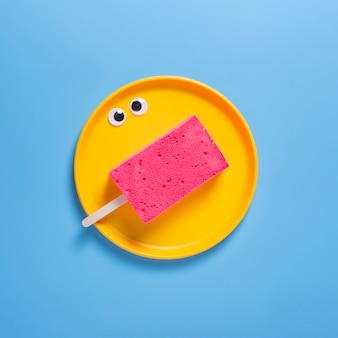 Top view of sponge on plate with blue background