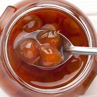 Top view spoon in jam jar