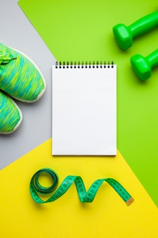 Top view sports equipment and notebook mock-up