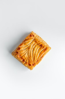 Top view of square pie decorated with patterns