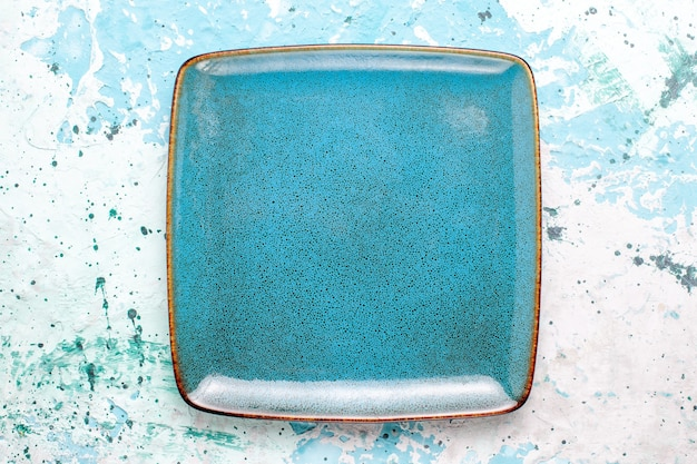 Top view square plate blue colored empty on light-blue surface plate glass color food