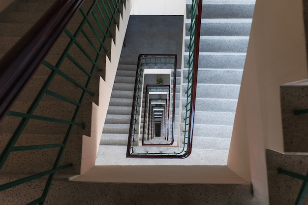 Top view of square shaped vintage staircase endless pattern on building