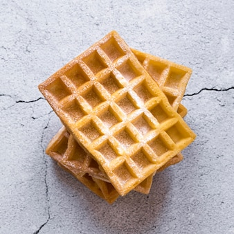 Top view of stack of waffles on concrete surface