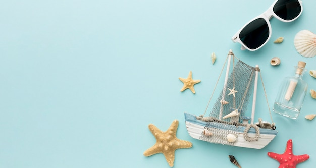 Top view starfish and sailing boat with copy space