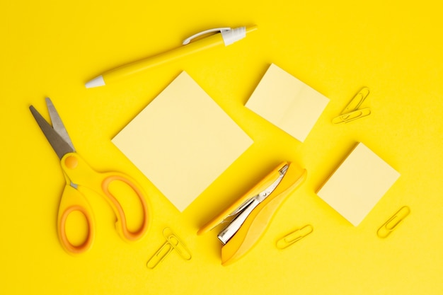Top view stationary arrangement on yellow background