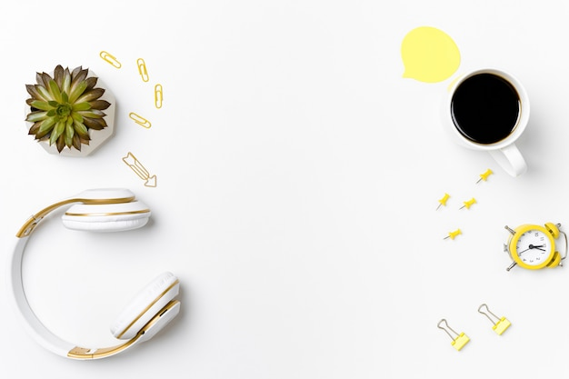 Top view stationery arrangement with headset mockup
