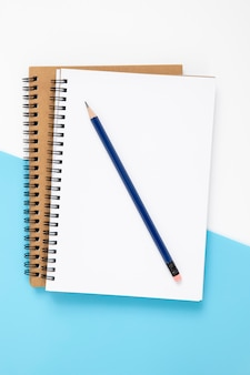 Top view stationery composition on bicolor background