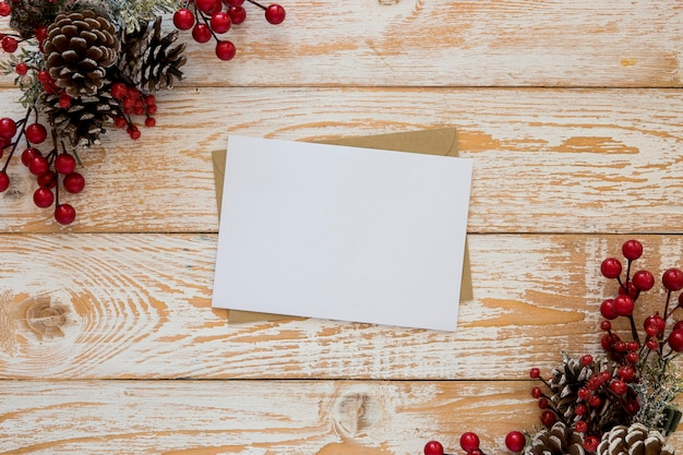 Top view stationery empty papers with christmas flowers
