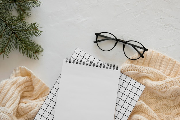 Top view stationery empty papers with reading glasses