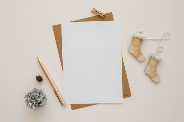 Top view stationery empty papers with winter decor