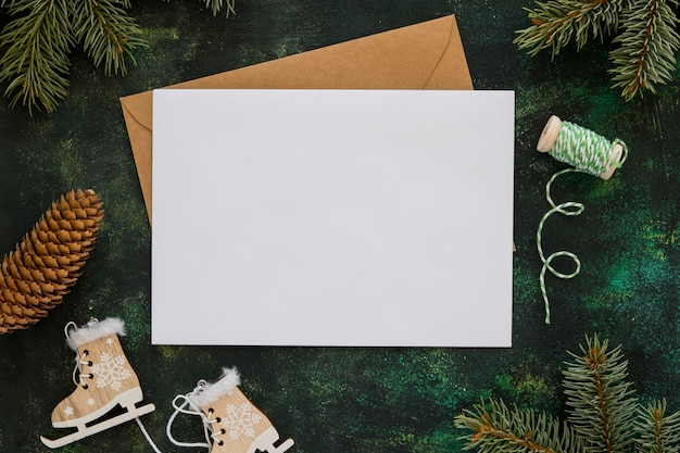 Top view stationery empty papers with winter decoration