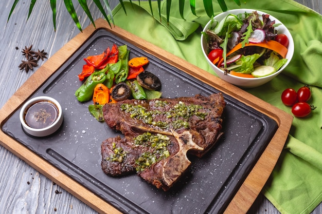 Top view steak with grilled vegetables and sauce