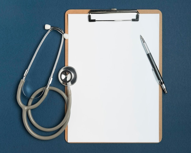 Top view stethoscope with clipboard and pen