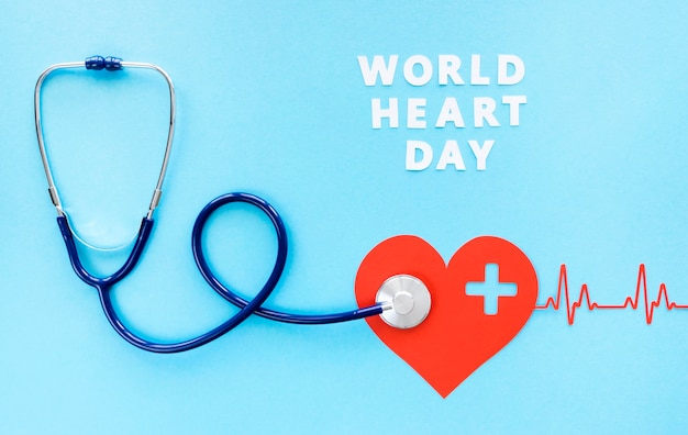 Top view of stethoscope with paper heart and heartbeat