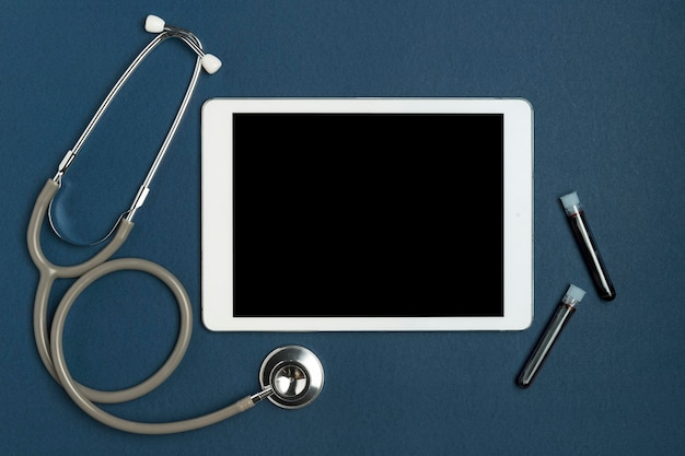 Top view stethoscope with tablet and blood samples